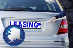 Alaska - silver car with LEASING painted in blue