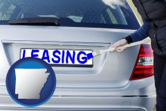 Arkansas - silver car with LEASING painted in blue