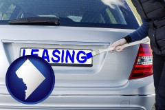 Washington, DC - silver car with LEASING painted in blue