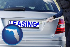 Florida - silver car with LEASING painted in blue