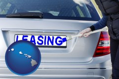 Hawaii - silver car with LEASING painted in blue