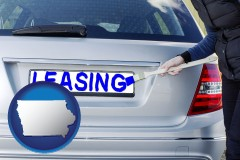 Iowa - silver car with LEASING painted in blue