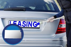 Kansas - silver car with LEASING painted in blue