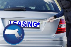 Massachusetts - silver car with LEASING painted in blue