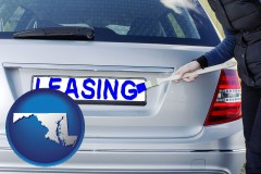 Maryland - silver car with LEASING painted in blue