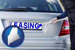 Maine - silver car with LEASING painted in blue