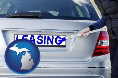 Michigan - silver car with LEASING painted in blue
