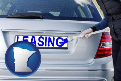 Minnesota - silver car with LEASING painted in blue