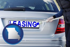 Missouri - silver car with LEASING painted in blue