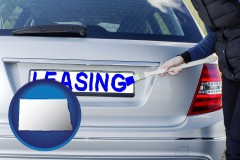 North Dakota - silver car with LEASING painted in blue