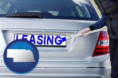 Nebraska - silver car with LEASING painted in blue