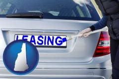 New Hampshire - silver car with LEASING painted in blue