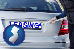 New Jersey - silver car with LEASING painted in blue