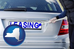New York - silver car with LEASING painted in blue