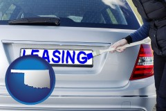 Oklahoma - silver car with LEASING painted in blue