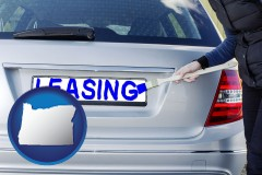 Oregon - silver car with LEASING painted in blue