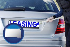 South Dakota - silver car with LEASING painted in blue