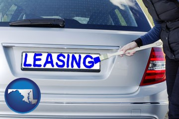 silver car with LEASING painted in blue - with Maryland icon